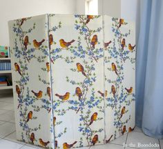 Using laminate boards to create a folding panel partition to hide the washing machine in the room, Hiding the Washing Machine theboondocksblog.com