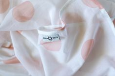 A versatile new-baby essential, in a muted shade of blush pink. Swaddle Wrap, Baby Swaddle, Baby Wraps, Baby Essentials, Organic Baby, Burp Cloths, Breastfeeding, Blush Pink, New Baby Products