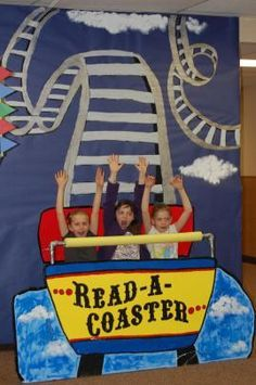 Amazing roller coaster backdrop idea! This was a book fair or library event. 3162557e733f5