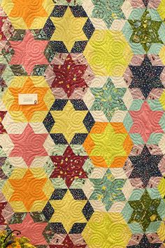 More triangle play ever kelly quilt by madebyrae, via Flickr