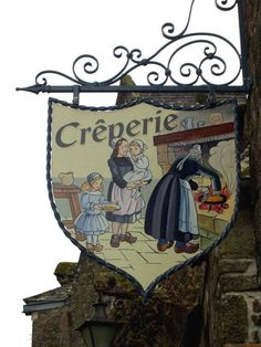 """Crêperie in Locronan, Brittany, France. I love these old """"Guild"""" type signs. Hanging Lanterns, Hanging Signs, Blade Sign, Celtic, Storefront Signs, Shop Facade, Pub Signs, Marquise, Shop Fronts"""