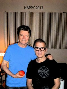 """David Bowie & Tony Visconti """"...he's singing in full voice, that voice you hear on Heroes, so loud that I literally had to step away from him in the studio."""" Tony Visconti"""