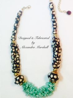 """What's not to love about this striking necklace by Alexandra Marshall? Fudge and cream spotted African Bone beads with Aqua mint Coral Cuppolini, and just a touch of gold washed brass. 19"""" long with 3"""" extender chain. $139. reference #2289. To order double click on the photo."""