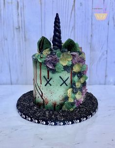 Zombie unicorn cake for Halloween birthday party.