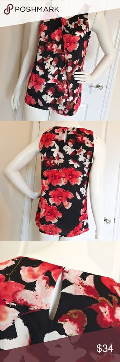 Dana Buchman Floral Black Pink Sleeveless Top S It's in excellent condition. The material is polyester. 26 inches long. It does have a very unnoticeable run on the front. It's not actively coming apart. Middle left of the last photo coming down from the neckline. Like I said, hard to find, even less so if someone is not looking right at it. Dana Buchman Tops Blouses