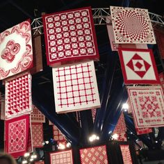 rileyblakedesigns's photo: Love the beautiful quilts on display at Quilt Market. Red and whites/creams... Always in style. #quiltmarket2014,#rileyblakedesigns