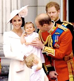 The Cambridges in the balcony of Buckingham Palace during the flypast marking Trooping the Colour.