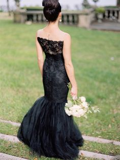 Oh how I dream of a daring bride in a black wedding dress that is elegant and chic, but not garish.