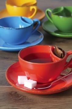 (A tea cup with a pocket for your tea bag. Great gift for $12.99.) I want to get these for people who actually drink tea now! by Eva