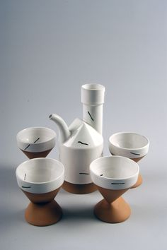 2004.2.0051 Teapot Set, c. 1985 Slip cast red stoneware, white glaze wtih black overglaze Gift of the American Ceramic Society