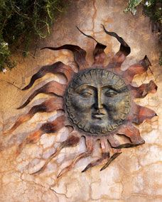 """Handcrafted wall decor. Copper tole rays. Hand-painted golden-wash resin face. 30.5""""Dia. x 3""""D. Imported."""