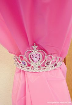 back curtains using princess tiaras. Such a cute idea for a little girls bedroom! - 26 Ideas For The Ultimate Disney Princess BedroomSuch a cute idea for a little girls bedroom! - 26 Ideas For The Ultimate Disney Princess Bedroom Disney Princess Bedroom, Princess Bedrooms, Princess Curtains, Princess Room Ideas For Girls, Disney Girls Room, Pink Princess Room, Princess Bathroom, Princess Bedroom Decorations, Disney Room Decorations