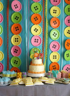 Love the paper plate buttons and suckers stuck in the top of the birthday cake
