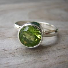 I want this - my bday's in August! Green Peridot Gemstone etsy-etsy-etsy