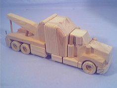 Some old wooden trucks sitting around-wrecker2.jpg