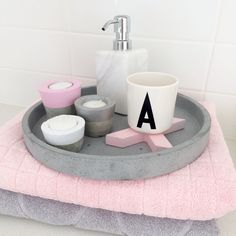 My bathroom essentials. Concrete, candle holders, marble, pink, grey, design letters.