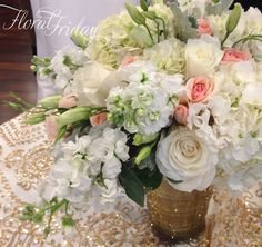 A fragrant blush and gold wedding table arrangement. By 1800Flowers|Flowerama Iowa City.