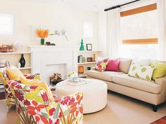 Samantha Pynn Design | Floral Print Wingback Chairs | Round Leather Ottoman