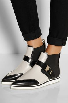 Concealed wedge heel measures approximately 25mm/ 1 inch Black and off-white leather Pull on