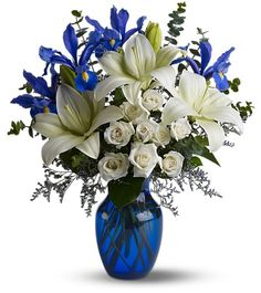 "NOUVEAU NAUTICAL Looking 4 a cool alternative 2 the avg arrangement? Get on board w our Nouveau Nautical Bqt! A vibrant & bold arrangement feat. luxurious white Asiatic Lilies, sparkling Spray Roses contrasted w/ Irises in a deep Egyptian blue shade & garnished w fresh greenery. Send this arrangement 2 celebrate the arrival of a new baby, 2 say ""Thank You"", impress UR potential ""First Mate"" or just b/c you're in the mood! One way or the other, we're sure that you'll be the Captain of…"