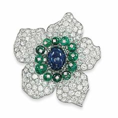A MID-20TH CENTURY SAPPHIRE, EMERALD AND DIAMOND CLIP BROOCH, BY CARTIER