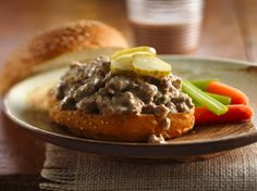 Browned ground beef and process cheese capture the great taste of cheeseburgers in a slow-cooker sandwich filling.