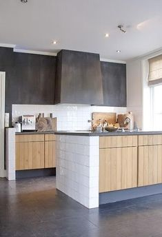 black + white + timber kitchen. I'd have the wood be darker