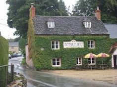 Bathurst Arms, North Cerney - a traditional 17th century coaching inn next to river Churn, serving award - winning food