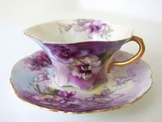 A gorgeous vintage / antique hand painted fluted teacup and saucer from the Rosenthal RC Versailles Bavaria factory. There is a purple and yellow