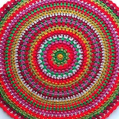 A large mandala - a circle of granny style crochet. You can use as a table centerpiece, for general decoration, or make in touch yarn for a small floor rug.