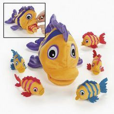 Plush School of Fish (7) :   When it's time to tidy up, the baby fish all fit inside the large fish, which has a touch fastener inside its mouth to keep the small fish safely inside.  (7 pcs per set.) Large fish: 33 cm; small fish: 9.53 cm.