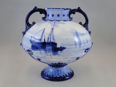 296) c.1900 Royal Crown Derby two handled blue/white vase depicting sailing barges (small chip to neck) 14cms tall Est. £20-£30