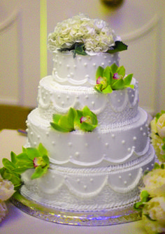The wedding cake, topped by white peonies, had a whimsical appliqué design.