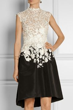 Oscar de la Renta Embroidered lace and faille dress $5,290  Oscar de la Renta's two-tone dress is beautifully made. The sheer top is closely cut from embroidered ivory lace and fitted with a beige organza underlay. The black faille skirt cinches at the waist and opens to a flaredhem. Wear this flattering design with feminine sandals and a box clutch.