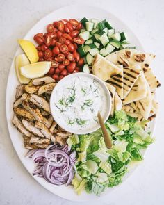 Chicken Gyro Salad with Tzatziki Dressing for Friday night dinner at home! Inspired by Happy weekend, xoxo.… Chicken Gyro Salad with Tzatziki Dressing for Friday night dinner at home! Inspired by Happy weekend, xoxo. Healthy Snacks, Healthy Eating, Healthy Recipes, Tzatziki Dressing Recipe, Gyro Salad, Great Dinner Recipes, Chicken Gyros, Salad Chicken, Friday Night Dinners