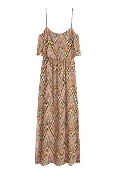 Patterned maxi dress: Maxi dress in a patterned viscose weave with a wide flounce at the top, narrow adjustable shoulder straps, an opening with a button at the back of the neck, an elasticated seam at the waist and slits in the sides.