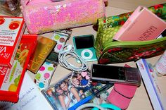 ... my note book, my phone, ipod nano, Roxy watch, fruity bars, cosmetics bags, my Kitty charm, now I can go :)     The New Roxy Go Ahead Shoulder Bag