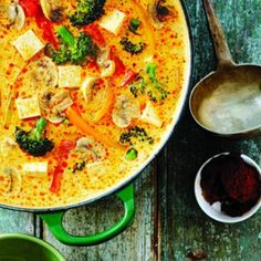 Golden Thai Curry Tofu Soup  1 leek or 1 onion  Vegetable oil  2 tbsp yellow Thai curry paste  1 tbsp  grated ginger  900-mL carton vegetable broth  1can of coconut milk  1 tbsp  sugar or honey  1 pkg tofu, extra-firm  12-oz pkg fresh or frozen vegetable stir-fry mix,  4 cups
