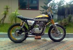 Engine, exhaust, stance, oil filter tank, bars, forks and side covers.