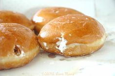 Krispy Kreme cream filled doughnut, my all time favorite doughnut!  haven't had one in a LONG time, but I sure want one now!