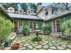Flagstone Patio with walking moss