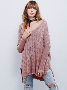 Easy Cable V neck Pullover | Super soft cable sweater featuring an effortless, oversized fit and a V-neckline.  Subtle high low and side vents.