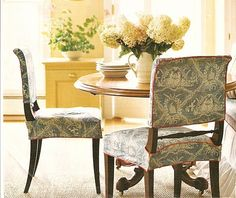 Simple chair slipcovers in blue toile with red piping