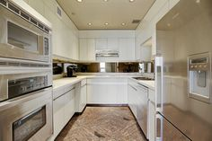 Highly Functional Kitchen with Stainless Steel Appliances.