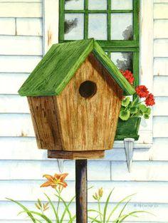 Birdhouse and geraniums