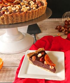 This vegan truffle tart is filled with chocolate ganache with a hint of rum chilled inside a hazelnut top for one decadent and delicious dessert.