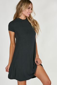 Casual mock neck short sleeve dress with flirty A-line hem. Slinky material with relaxed fit. - Modal-Polyester blend - Imported - Model is wearing size S - Runs true to size - Hand wash cold - Approx
