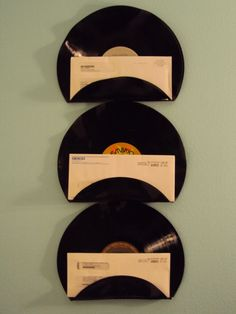DIY LP mail holders. Mark a straight line, warm evenly with a chef's torch or candle flame along the line, bend evenly and let cool. Install using appropriate wall fastener screw, that has a head diameter slightly larger than the LP hole.