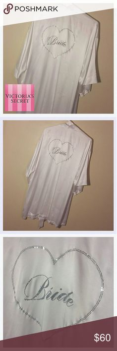 NWT! Victoria's Secret Bride Robe NWT! -S New With Tags. Gorgeous perfect condition. The end of the tie says I DO in rhinestones. The back says Bride in glitter and a heart of rhinestones. It's labeled one size. No flaws. Normal one size women's robe size. So so cute!! Great gift for the bridal shower! Tags look perfect too! 100 % Polyester Uber soft! Perfect to wear when getting ready for your big day! And any other day before that you see fit! Because you're the Bride and you're allowed…