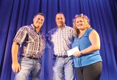 Sean Thomas (left) and Curtis Whitford (centre) of the Fort St. John Petroleum Association presented Kerri Kitzul of the North Peace Gymnastics Club with a $5,000 cheque at the club's Fundraising Gala and Comedy Night at the Pomeroy Hotel Saturday night. The funds were raised at the Petroleum Association's Family Camp Weekend in August.